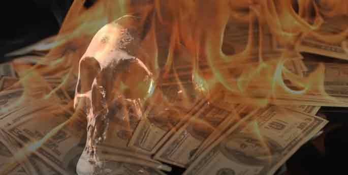A screen cap of the video with a skull set on fire with bills